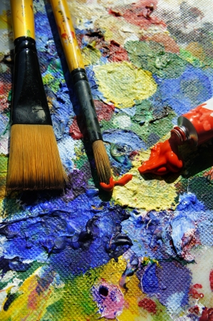 Mixing paintings and paintbrushes lying on the art palette Stock Photo - 17573045