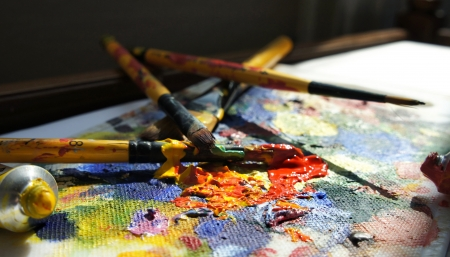 Mixing painting and paintbrushes   Stock Photo