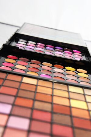 Cosmetic palette over white background with a lot of vivid bright colors     photo