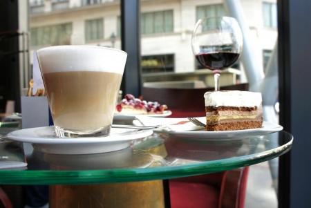 Latte, fruit cake and tiramisu in Parisian cafe