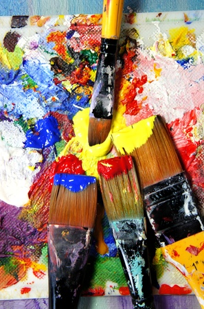Vivid playful strokes and paintbrushes  photo