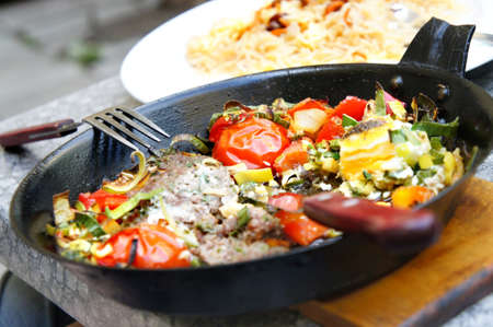 Fresh prepared meat with vegetables served in the pan    photo