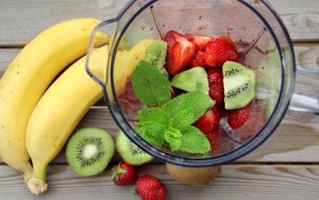 Fresh vivid smoothie ingredients and blender