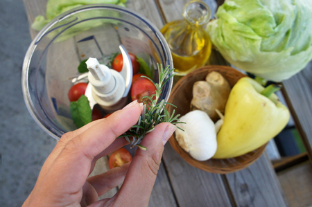 Mix of vegetables for salad on the summer terrace  Stock Photo
