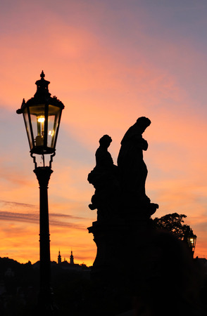 Amazing sunset on the Charles bridge photo