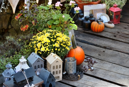 Halloween decorations with pumpkin and other decor objects