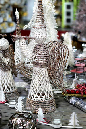 knitten: Big mix of Christmas decorations on the table with hanmade angel and other toys Stock Photo