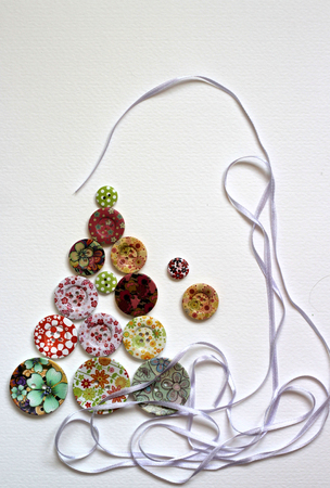 Paper Christmas tree decorated with vivid buttons  photo
