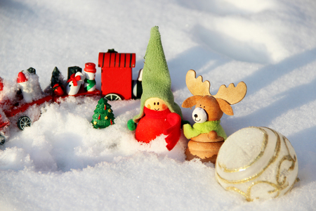 Christmas decoration small funny boy with elk in the snowdrift photo