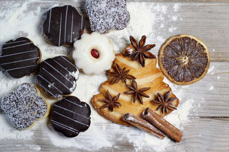 Mix of Christmas cookies with cinnamon, chocolate glaze and coconut photo