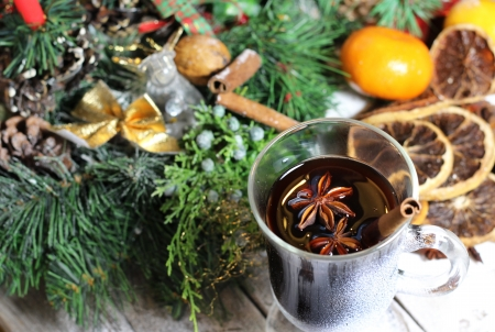 Traditional Christmas punch, dried oranges, wreath, cinnamon and anise photo