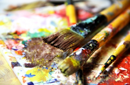 colours tints: Beautiful vivid art palette and mix of paintbrushes in fresh paint