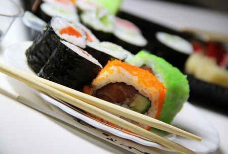Mix of Japanese sushi and rolls on the table  photo