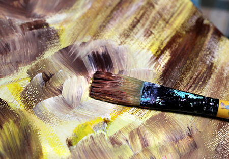 Paintbrush and beautiful painting of flowers in brown and yellow colour photo
