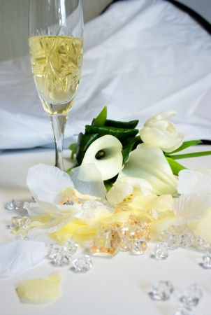 callas: Beautiful wedding bouquet of white callas and tulips lying on the table