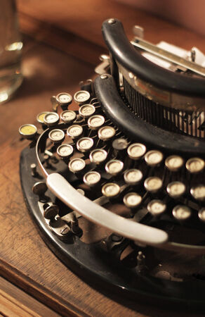 Old vintage retro wooden typewriter on the table photo