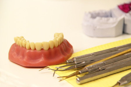 Mix of Dental tools in stomatological clinic, white background photo