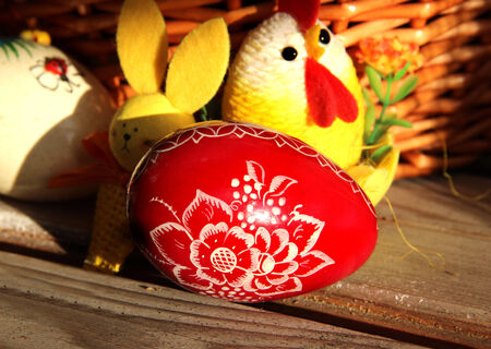 Mix of beautiful handmade Easter colored eggs in the basket photo