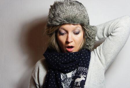 glows: Beautiful young posing woman in the knitwear Stock Photo