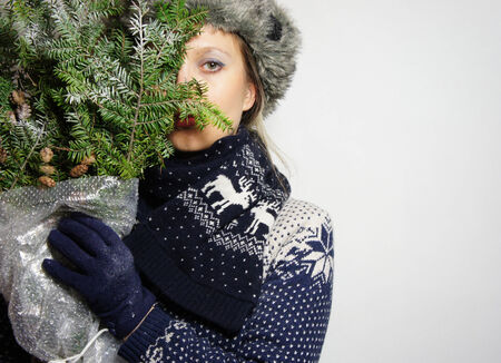 Beautiful young posing woman in the knitwear photo