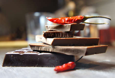 sexy food: Pieces of chocolate with hot chili pepper Stock Photo