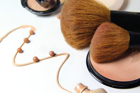 powder room: Make-up, foundation and brushes on the white background Stock Photo