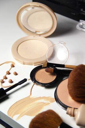 Make-up, foundation and brushes on the white background Stock Photo