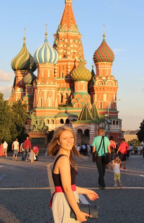 Beautiful young woman on the Red Square, Moscow, Russia