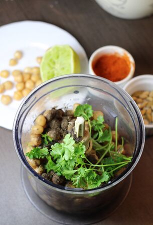 Hummus preparation with parsley and chickpeas and lime