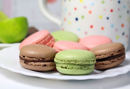 Mix of multicolored French macarons on the white table Stock Photo