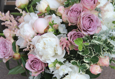 Beautiful wedding bouquet with a lot of tender flowers including peony and rose