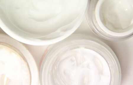 Mix of face creams for beautiful skin, isolated on white background