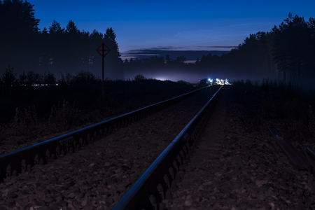 Railway leading to railroad maintenance work done in the night  Stock Photo
