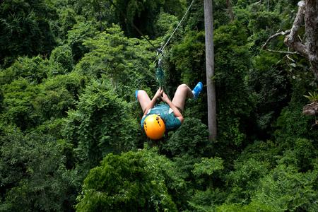 A woman having fun doing zipline ride