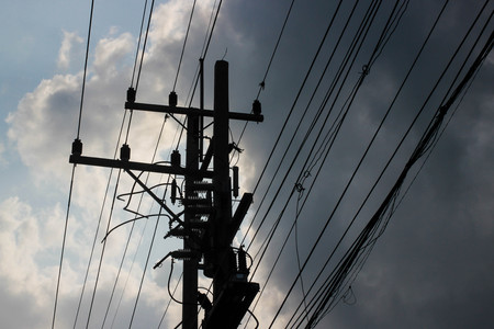 power cables: Silhouette electric pole with cloudy on sky.