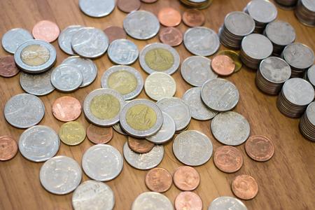 Group of Thai baht coin on wooden floor. Stock Photo