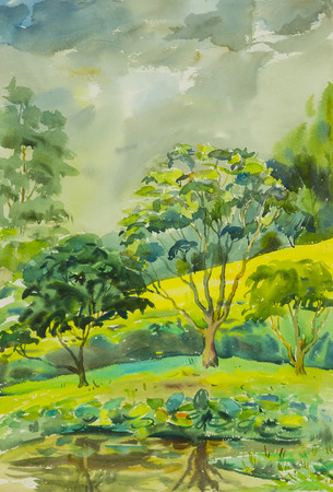 Watercolor landscape painting colorful of Trees along the pond and emotion in blue background .Original painting.