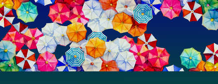 Multi colored umbrella Watercolor painting top view colorful of summer holiday and tourism business sea, beach resort, market, texture, blue background. Hand painted abstract illustration, copy space Reklamní fotografie