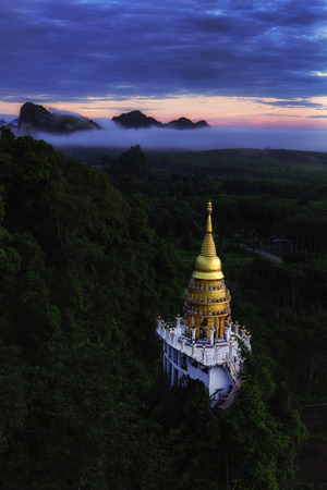 Beautiful pagoda at sunrise on the top  with fog at Khao Na Nai Luang Dharma Park,Surat Thani province,Thailand.