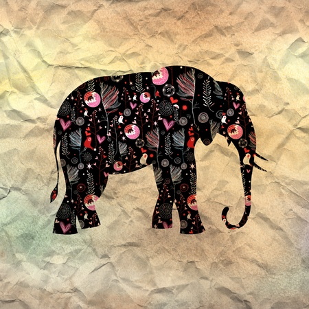beautiful ornamental elephant on textural background photo