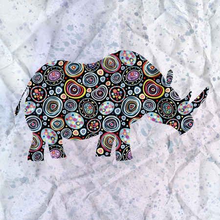 beautiful ornamental silhouette of rhinoceros on the textural background Stock Photo