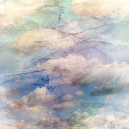 구겨진 된 수채화 용지에 구름과 아름 다운 빈티지 배경 스톡 콘텐츠