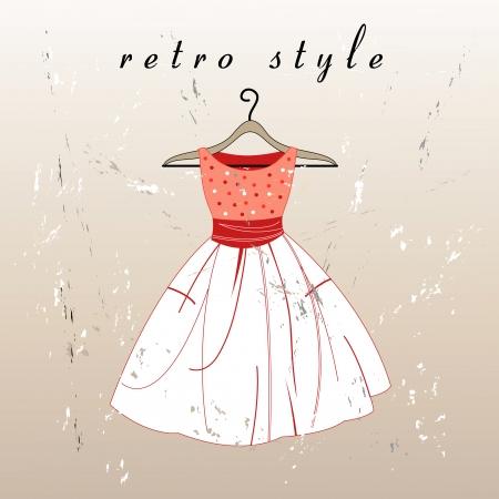 traje de gala: hermoso vestido retro en una percha en el fondo de textura