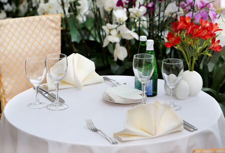 banquet facilities: served table in a restaurant with appliances