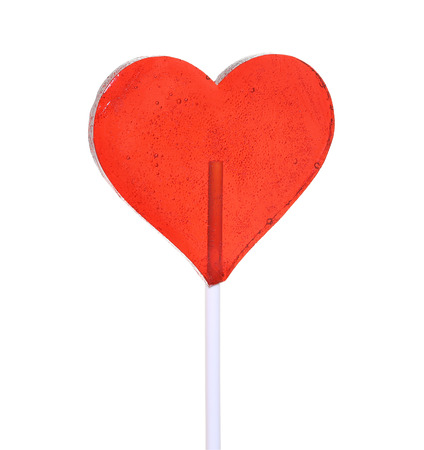 bright red heart shaped lollipop on a white background