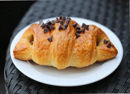 appetizing fresh croissant on a dark background