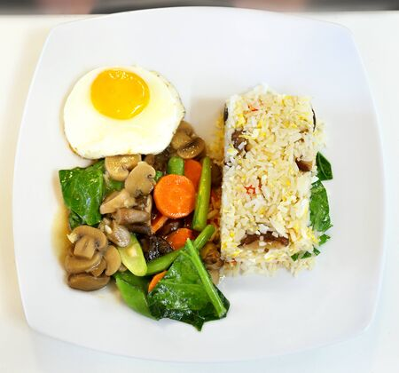 lunch with rice and fried eggs and vegetables with bends