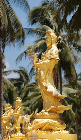 mercy: beautiful statue Guan Yin Chinese Goddess of Mercy in the palm grove