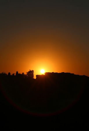 to reassure: bright beautiful sunset over the ancient ruins