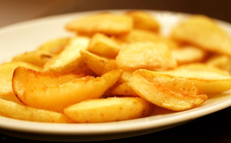 Delicious potato slices in the plate is photographed close up